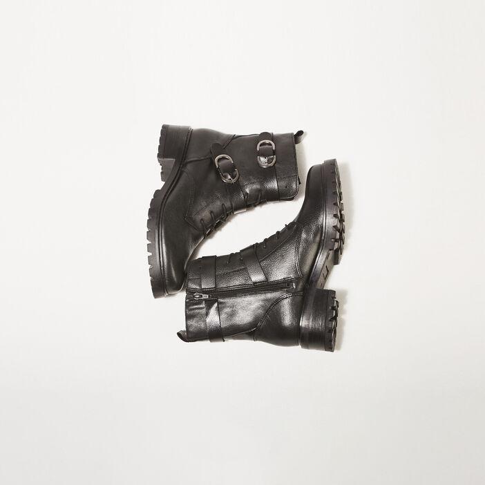 Bottines plates avec boucles noir femme