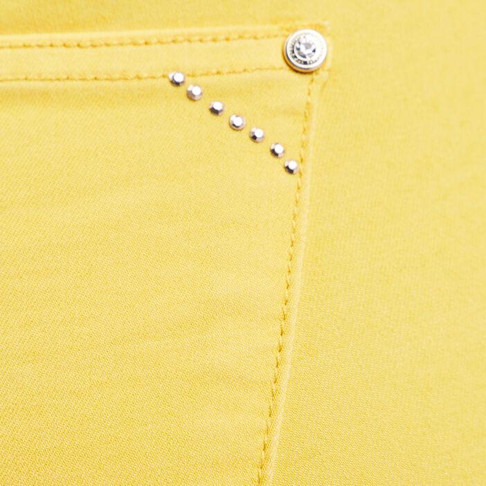 Pantalon ajusté détails studs jaune femme